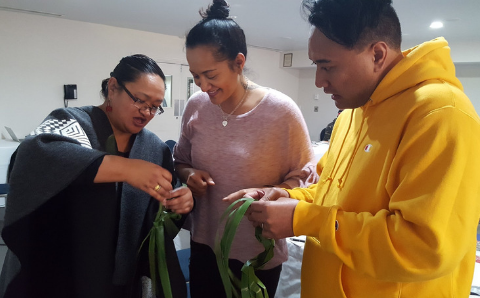 From left to right: Wikitoria Pirihi, Malia Eyles and Beaudine Tahau participating in a workshop run by Riria McDonald and Wikitoria Pirihi on mahi raranga in a Pūtaiao context at the Ako Panuku Hui ā Tau